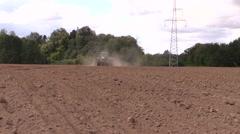 Machine spread fertilizer on cultivated field soil Stock Footage