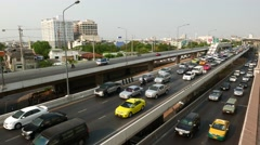 Slow traffic movement on different road levels, evening congestion Stock Footage