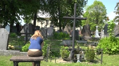 Woman experience painful father husband son man loss in cemetery. 4K - stock footage