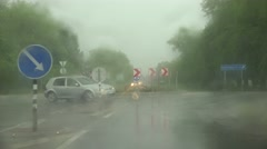 Car go on city road roundabout and rain fall. Bad weather conditions. 4K Stock Footage
