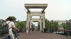Cyclists Along the Magere Brug 2 Stock Footage