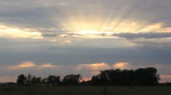 Evening storm sky with sun beams in a summer field Stock Footage