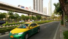 Parallel ways traffic on road, train move on elevated railways, green urban city Stock Footage