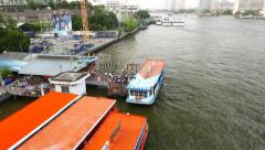 River ferry make fast to wharf, commuters disembark from the boat, top view Stock Footage
