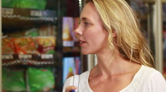 Pretty blonde checking grocery list Stock Footage