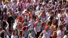 Dirty people at Festival of colours Holy at Barcelona. Stock Footage