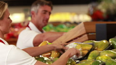 Smiling workers stocking vegetables - stock footage