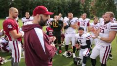 Coach football team talks with the players. - stock footage