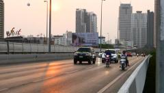 Traffic on King Taksin Bridge at sunny evening, perspective view Stock Footage