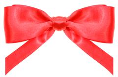 Stock Photo of symmetric red ribbon bow with vertically cut ends
