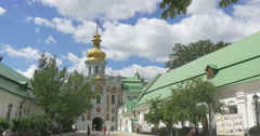 A Splendid Bell Tower With a Golden Dome and a Narrow Corridor Under it Stock Footage