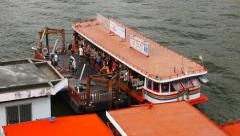 Commuters debark from cross river ferry boat, view from top point Stock Footage