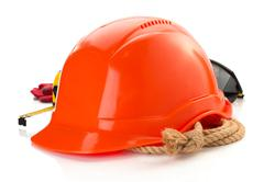 Construction helmet and safety glasses on white Stock Photos