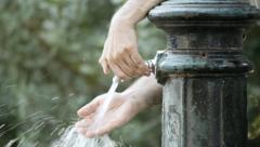 Fountain in park washing hand close-up Stock Footage