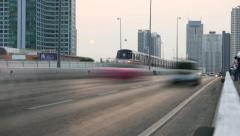 Fuzzy smooth traffic timelapse effect urban road in dusk, overground metro train Stock Footage