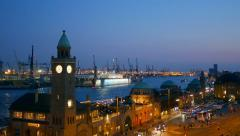 Landungsbruecken and the harbor at night in Hamburg, Germany Stock Footage