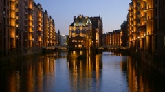 Part of the old Speicherstadt in Hamburg, Germany. Illuminated at night Stock Footage