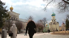On the territory of the Holy Trinity St. Sergius Lavra, people walking Stock Footage