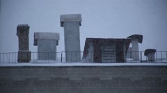 Snowfall on the background of the chimneys - stock footage