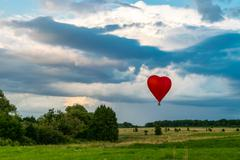 Hot air balloon in the evening sky Stock Photos