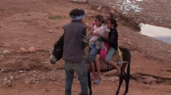 Child making a stroll on a Donkey in Morocco Stock Footage