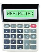 Calculator with RESTRICTED - stock photo