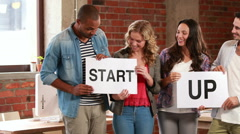Casual business team holding start up signs Stock Footage