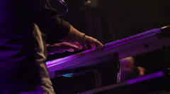 Slow motion of keyboard player at concert Stock Footage