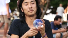 Street performer juggling glass bowl on the street in Bangkok, Thailand Stock Footage