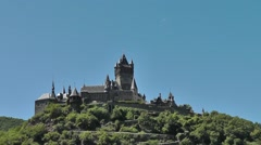 Reichsburg Cochem on a sunny day with the moon in the background Stock Footage