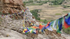 Colorful Buddhist prayer flags near Buddhist monastery in Ladakh, India Stock Footage