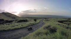 Biker riding volcanic road Stock Footage