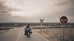 Pilot of motorcycle enjoying the view Stock Footage