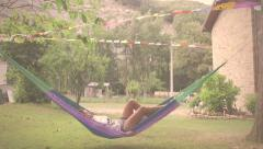 Woman on hammock in vacation Italy Stock Footage