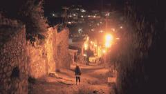 Woman walking in a dark alley Stock Footage