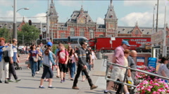 Tourists at the Amsterdam railway station Stock Footage