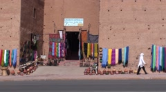 Seller in front of the Kasbah in Morocco Stock Footage