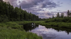Northern Maine: Reflective River in Lush Woods Stock Footage
