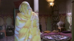 Woman and Inside of the Kasbah Nkob in the valley Gorges of Dades Stock Footage
