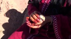 Woman Berber holding a chick in the hands Stock Footage