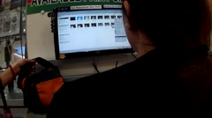 Desktop operator searching image files Stock Footage