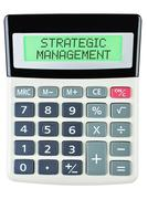 Calculator with STRATEGIC MANAGEMENT Stock Photos