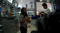 Department store saleslady working Stock Footage