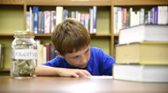 Education Library Boy Saving for College Stock Footage