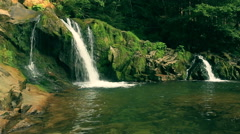Mountain waterfall. Distant Stock Footage