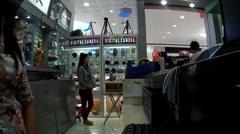 Department store saleslady waling away Stock Footage