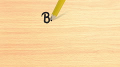 Back to school writing on wooden desk Stock Footage