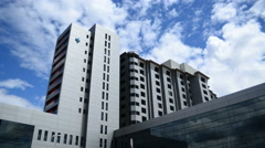4K Health care Hospital exterior with blue sky and time lapse clouds Stock Footage