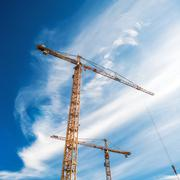 Cranes Working on Construction Site Stock Photos