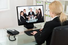 Young Businesswoman At Desk Video Conferencing With Colleagues On Computer In Kuvituskuvat